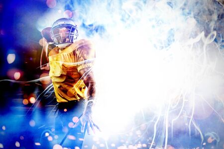Energetic American football player holding ball against firework bursting sparkle background