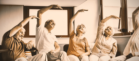 Seniors doing exercises in a retirement home