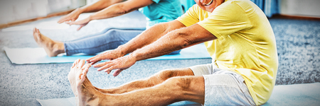 Portrait of seniors stretching legs in studio Stok Fotoğraf