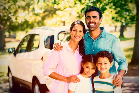 Portrait of happy family on a picnic standing next to their car Stock Photo