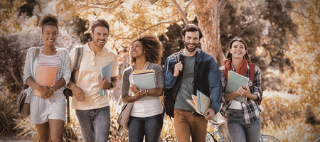Group of college friends walking in campus Stockfoto