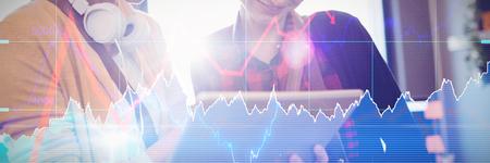 Stocks and shares against two female graphics designer using digital tablet