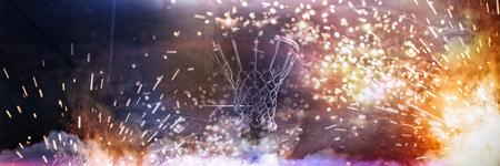 Basketball hoop hanging against a dark background