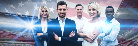 Confident business people with arms crossed standing over white background against close-up of an american flag