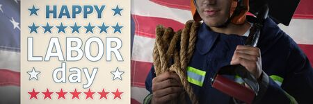 Professional Fireman against close-up of an american flag. USA Labor Day Concept Advertisement. USA Labor Day Concept Advertisement Stock Photo