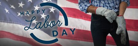 Worker putting on working gloves against close-up of an american flag. USA Labor Day Concept Advertisement. USA Labor Day Concept Advertisement