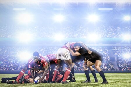 Rugby player scrum against digital image of crowded soccer stadium Фото со стока