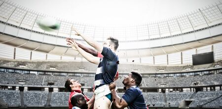 Rugby Players Playing Match against rugby goal post on a sunny day in the stadium Фото со стока