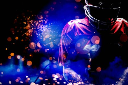 American Football Player against firework bursting sparkle background