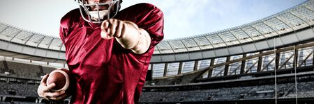 American Football Player against rugby stadium on a sunny day Imagens