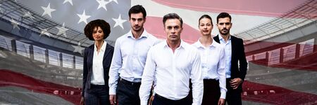 Confident business people walking against white background against close-up of an american flag