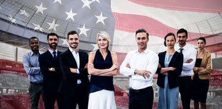 Diverse smiling business team against close-up of an american flag Фото со стока