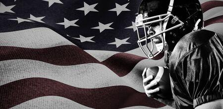 American Football Player against focus on usa flag Фото со стока