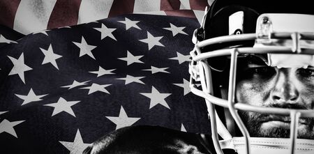 American Football Player against focus on usa flag 免版税图像