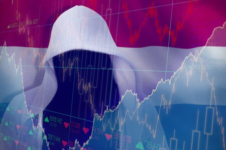 Robber in gredy hoodie against stocks and shares
