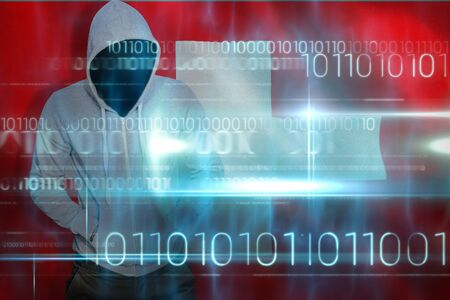 Robber in gray hoodie with hands in pockets against blue technology design with binary code