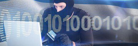 Burglar shopping online with laptop against binary code on digital screen
