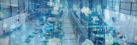 Cloud computing and icons against machinery in a factory warehouse building Stock Photo