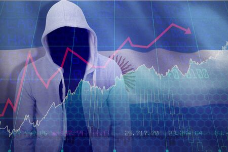Robber wearing gray hoodie against stocks and shares 免版税图像