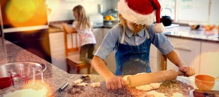 Composite image of brown parquet against brother and sister making christmas cookies at home Stock Photo