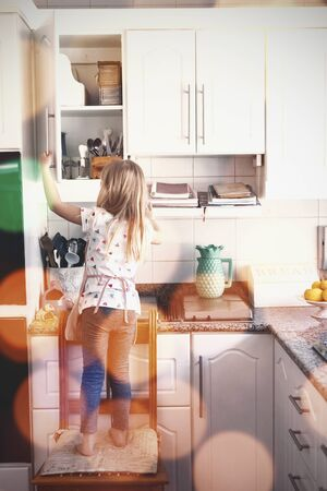 Composite image of brown parquet against girl making christmas cookies at home