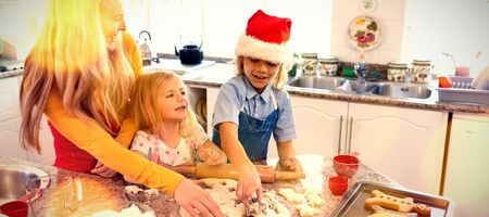 Composite image of brown parquet against family making christmas cookies at home