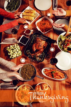 Illustration of happy thanksgiving day text greeting against millennial adult friends celebrating thanksgiving together at home  Stock Photo