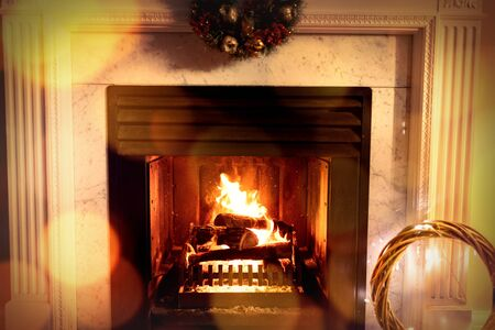 Composite image of brown parquet against fireplace at christmas time Stock fotó