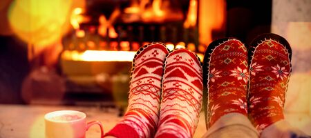 Composite image of brown parquet against couple at home at christmas time Banco de Imagens