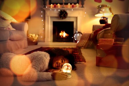 Composite image of brown parquet against girl at home at christmas time