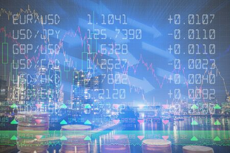 Financial figures of stock against downtown with light trail and river