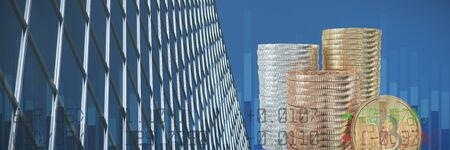 Financial figures of stock against low angle view of office building against blue sky