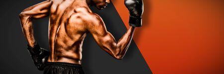 Muscular boxer against black metal texture Zdjęcie Seryjne - 134784741