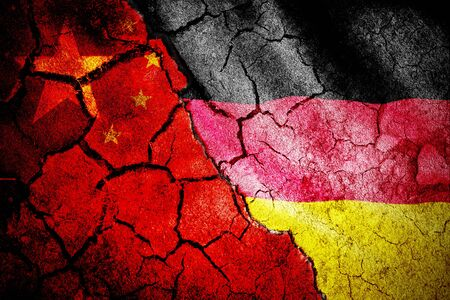Digitally generated german national flag against close-up of chinese flag
