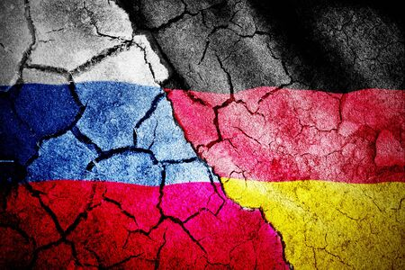 Digitally generated german national flag against digitally generated russian national flag