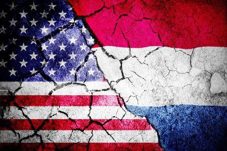 Digitally generated netherlands national flag against digitally generated american national flag