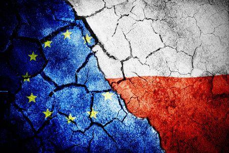 Digitally generated polish flag rippling against close-up of european flag