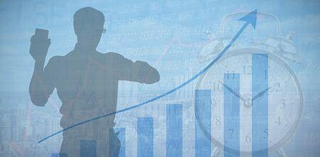 Silhouette businessman holding smart phone against blue data 스톡 콘텐츠