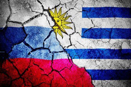Digitally generated uruguay national flag against digitally generated russian national flag