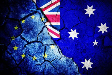 Australian flag against close-up of european flag Stok Fotoğraf