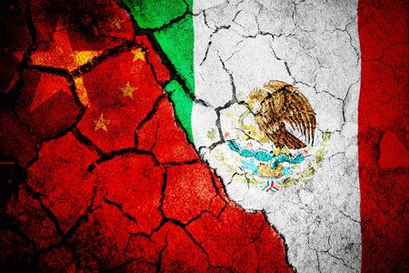 Digitally generated mexican national flag against close-up of chinese flag