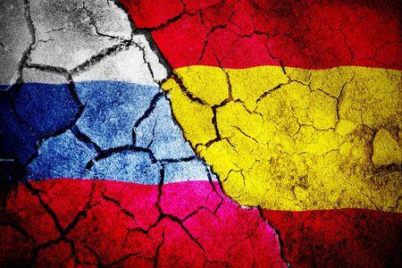 Digitally generated spanish national flag against digitally generated russian national flag