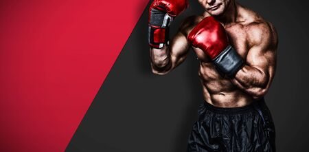 Portrait of boxer with red gloves against black metal texture 版權商用圖片