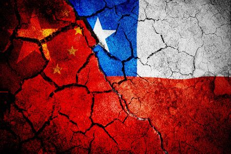 Digitally generated chile national flag against close-up of chinese flag Stok Fotoğraf