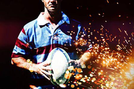 Rugby player against firework bursting sparkle background