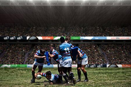 Rugby players against spectators at soccer stadium Reklamní fotografie