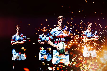 Rugby players against firework bursting sparkle background