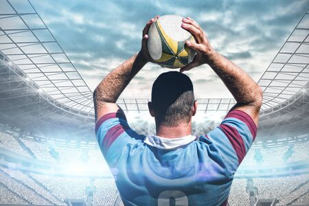 Rugby player against soccer stadium