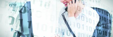 Binary code on circuit board against smiling businesswoman using landline phone and computer in office Banco de Imagens