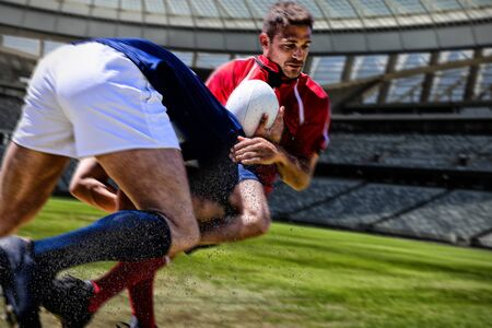 Rugby Player against rugby stadium on a sunny day